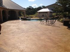 acid stained concrete pool deck- walk out the door and swim