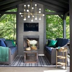 [@bpatrickflynn] When I first decided to move to the mountains for a slower pace of life, I knew I wanted one spot outside where I could surround myself with all the creature comforts of an indoor room regardless of the weather. All it really took to transform the space was black paint on the beams, ceiling and railing along with some lightweight stone veneer for the fireplace. Nine times out of ten you'll catch me out here glued to the TV for marathons of House Hunters International or Tiny…