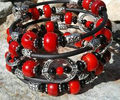 Check out this item in my Etsy shop https://www.etsy.com/listing/536261537/red-coral-black-silver-memory-wire-wrap
