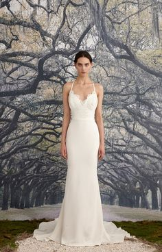 Mermaid gown with a beaded corded scalloped lace bodice and simple waistband. Scalloped deep-v front and back neckline with scalloped lace detail. Criss cros...