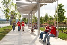 Mobility + Connectivity (&) Aesthetics + Design – Swings overlooking walkway and river at John G. and Phyllis W. Smale Riverfront Park