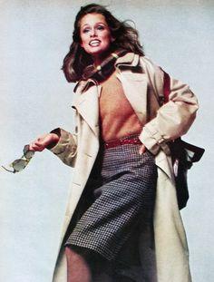 Lauren Hutton is wearing a classic oversized men's raincoat by Ralph Lauren Photo Richard Avedon. Vogue US August 1973