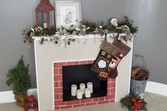 How to Make a Cardboard Christmas Fireplace. If your image of Christmas includes stockings hanging on a fireplace but your home doesn't have one, you can make a surprisingly realistic version from cardboard. Start with four cardboard display boards -- the kind students use for science projects. You can find them at hobby or office supply...