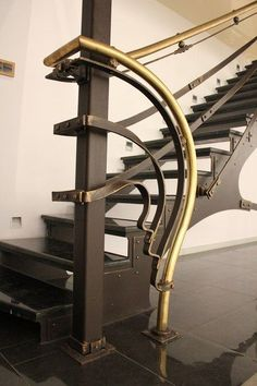 Floating metal stairs with metal banding and art nouveau detailing