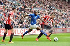 Wes Morgan of Leicester City in action with Connor Wickham of Sunderland during the Premier league match between Sunderland and Leicester City at The Stadium of Light on May 16, 2015 in Sunderland, England.
