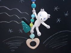 Arctic fox hanging toy, Car seat toy, Pram toy, Stroller toy, activity center toy, Rattle, play gym toy, arctic mobile, wooden teether. This hanging toy features an arctic fox with a fur - tree. A carefree arctic fox will add happiness and fun to your baby's plays and trips. There is a rattle inside the toy so it makes pleasant sounds when a baby plays with it. Soft crochet animal is handcrafted with a heart shaped teething toy. The toy can be easily tied to a car seat, baby play gym…