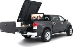 Tailgating can be a harrowing business without the proper gear or equipment. Dubbed as the ultimate tailgating vehicle, the Toyota Midnight Rider Tundra Tailgater has you covered! This vehicle is built with a slide-out tailgate thats equipped with an infrared BBQ grill, ice-cold beer tap, ample ice chest, chilled condiment trays, dual cutting boards, 42 HD Plasma TV  8-speaker Kicker sound system with 12 sub.  FWIW, this one is on my Christmas list, Honey! See