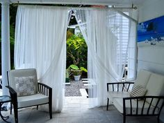 Curtains separate patio from path in Amherst NY. This gardener uses a black-and-white theme. Outdoor Curtains For Patio, Black And White Theme, Curtain Material, Cool Plants, Home Projects, Garden Landscaping, Window Treatments, Pergola, House