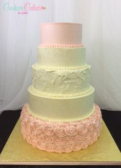 Ivory and blush wedding cake covered in sparkles