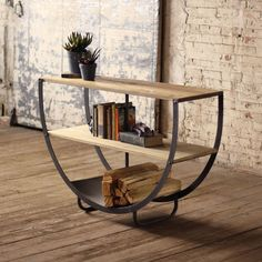 This is a classic piece of furniture with a semi-circle shape and two wooden shelves. This console can the focal point of your living room. Product:ConsoleConstruction Material:Wood &amp MetalStyle:In Decor, Furniture Design, Industrial Chic Furniture, Furniture Sale, Modern Furniture, Furniture, Iron Furniture, Home Furniture, Home Deco