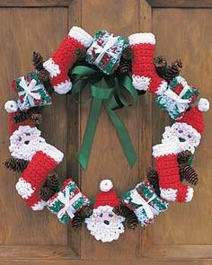 Ho ho ho! Jolly Santas, wrapped presents, and stockings circle this very Christmasy wreath. Crocheted in Lily Sugar n Cream with 4 mm (U.S. G or 6) crochet hook. Assorted other craft supplies required.