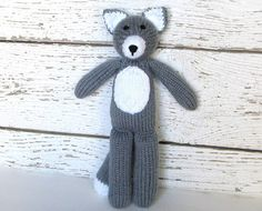 This hand knitted gray wolf stuffed animal is soft, cuddly and ready to hug. A knit toy sure to be adored by children of all ages.