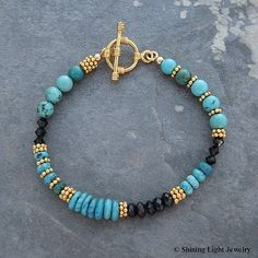 This one of a kind bracelet is made with a variety of natural turquoise beads, faceted black garnets, and jet black Swarovski crystals. The toggle clasp and Bali style beads are vermeil.