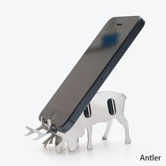 Antler - Smartphone Cradle   CKIE This is made from Stainless Steel, but I reckon an acrylic version would work too.