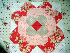 This quilt block resembles a flower when done. Can you imagine a whole quilt with sashing done up?