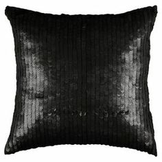 """Cotton pillow covered in black sequins.  Product: PillowConstruction Material: Cotton cover, sequins and polyester fillColor: BlackFeatures: Insert includedSequin detailsDimensions: 18"""" x 18"""""""
