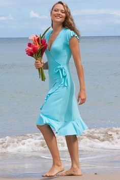 Island Importer - Mele Dress - This sassy, form-fitting, faux-wrap dress in stretch-jersey is cute and comfortable. Features capped-sleeves, ruffled hem, and bow accent.  You can keep wearing this versatile number long after the wedding!