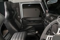 Land rover defender with body kit, custom leather upgrade seats, auto grain leather trimmed door panels, cubby box & lid www.ruskindesign.co.uk with ruskin design logo