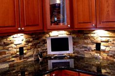 Making the existing black granite countertops work...wood tone and/or stacked stone?