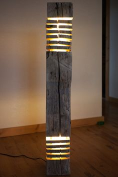 Rustic barnwood floor lamp features two lights on the top and bottom. Made of reclaimed barnwood so its eco-friendly, and has that