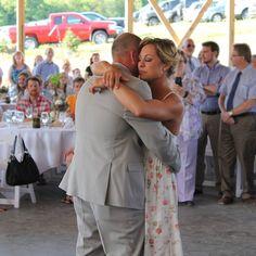 The newly married couple share a dance.