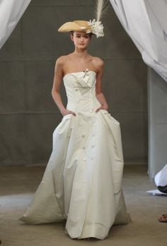 Carolina Herrera wedding dresses for Spring 2013 shine with glamorous simplicity. Inspired by fashion portraits of late photographer Cecil Beaton, this bridal collection looks beyond the trends to honor a bride's personal style.
