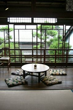 A chabudai (Japanese low dining table with short legs) in a traditional setting. People seated at a chabudai may sit on zabuton or tatami rather than chairs. Image via Pinterest