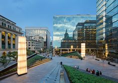 In the plaza, new crystalline glass forms double as seating for the public. The… – architecture Landscape Architecture, Landscape Design, Landscape Photos, Plaza Design, System Furniture, Public Realm, Radiant Heat, Office, Landscape Lighting