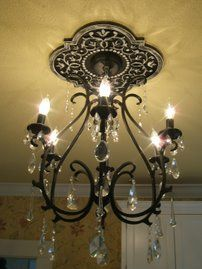 "22"" Mediterranean Vine Ceiling Medallion by Marie Ricci.  Shown in distressed black. www.mariericci.com $170"