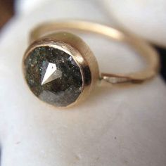 This olive green cut diamond ring. | 65 Impossibly Beautiful Alternative Engagement Rings You'll Want To Say Yes To