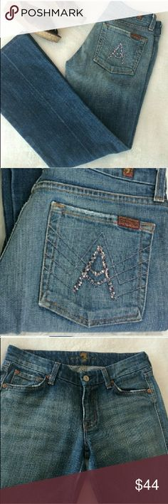 """7FAMK Pink Rhinestone A Pocket Boot Cut Jeans These jeans have little distressed details all over. Pink rhinestones adorn the pockets to give that 7FAM special touch. They are an ombr? style wash.  They are used but still in good condition with no stains.  28"""" inseam.  They have minimal stretch.  98% cotton 2% polyurethane 7 For All Mankind Jeans Boot Cut"""