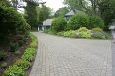 Simple Plants for Driveway Entrance | This wide driveway is both appealing and functional, providing plenty ...