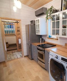 The Winter Wonderland's galley kitchen has a farmhouse sink, washer/dryer combo, full size oven, IKEA cabinets, and an apartment size refrigerator. A giant pantry and upper cabinets provide lots of storage space.