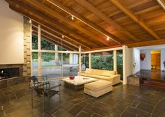 Mid Century Modern Flooring natural materials and finishes predominate, with fir ceilings