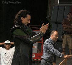 Tom Hiddleston (Loki) gives a double thumbs up for his co-stars in this behind the scenes GIF. Stellan Skarsgard (Dr. Selvig) watches them as well in the background.