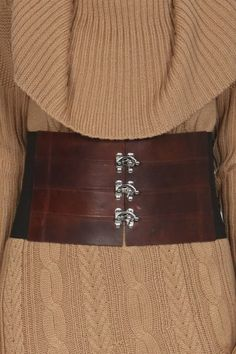 Chocolate leather triple hinge corset belt. I would have features on this to function as a utility belt in the field - i.e. vial holders for specimen collecting, fountain pen, ink vial, compass, note book, and map.