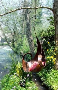 Elven swing.  Such a beautiful riverside seat!(note to self;my garden needs a river running beside it!!!!)