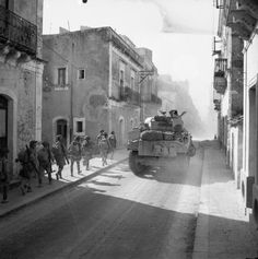 British soldiers advance in Carlentini, Sicily - Italy 1943