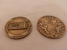 2 medalhas em bronze: 1 moeda Associação Comercial da Bahia; 1 moeda 1o. Centenário da Associação Comercial do Rio de Janeiro.