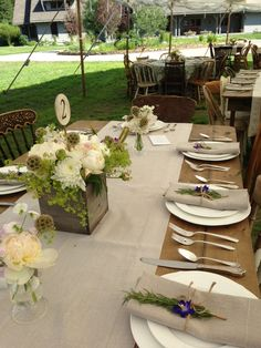Simple elegant design on vintage tables with mismatched vintage chairs under a sail cloth tent....stunning