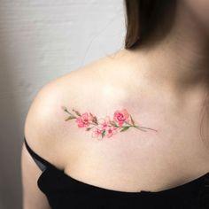 Flower tattoo looks so feminine and gentle.