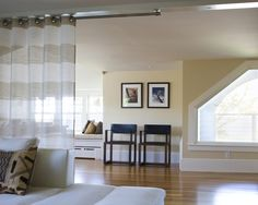 Use a curtain rod attach to the ceiling instead of the wall and favorite fabric to divide a room.