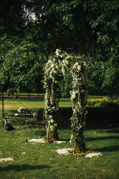 Outdoor natural woven arch is the perfect backdrop for any couples nuptials