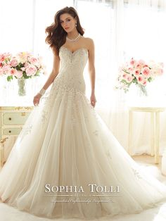 Sophia Tolli - Y11637 � Marquesa - Strapless dream taffeta and misty tulle full A-line wedding gown, sweetheart neckline trimmed with crystal and pearl hand-beading, beaded lace appliqu� bodice with dropped waist, back corset, appliqu�s cascade down skirt and chapel length train. Removable spaghetti and halter straps included.Sizes: 0 � 28Colors: Almond, Ivory, White