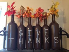 My Thanksgiving wine bottle decorations - or do in chalk board paint so you can change the letters