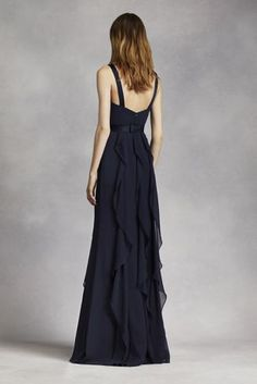 This V-neck wrapped bodice dress is timeless and romantic; perfect for your wedding party or any special occasion!  Sleeveless V-neck wrapped bodice is adorned with an elegant satin belt.  Long, soft chiffon skirt features cascading bias cut ruffles.  Sizes 0-26.  Fully lined. Back zipper. Imported chiffon. Dry clean only.