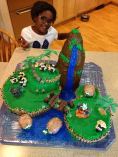 Coolest Birthday Cake - Skylanders.  Made this for my son's birthday.  Idea inspired by Lisa from Ontario. 4 cake mixes, fondant, chocolate candies, cookies and licorice.  Top half of the mountain and turtles are made from Rice Krispie treats.