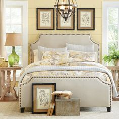 Romantic and cozy, the Parker Nailhead Trim Bed is a comfortable favorite. An upholstered headboard and footboard are covered in a luxurious, parchment-co...