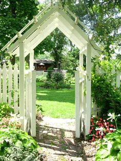 Garden arbor entrance to tie in with simple white picket fence.