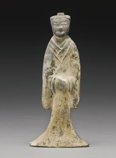 A PAINTED POTTERY FIGURE OF A STANDING MALE ATTENDANT, HAN DYNASTY. Sotheby's